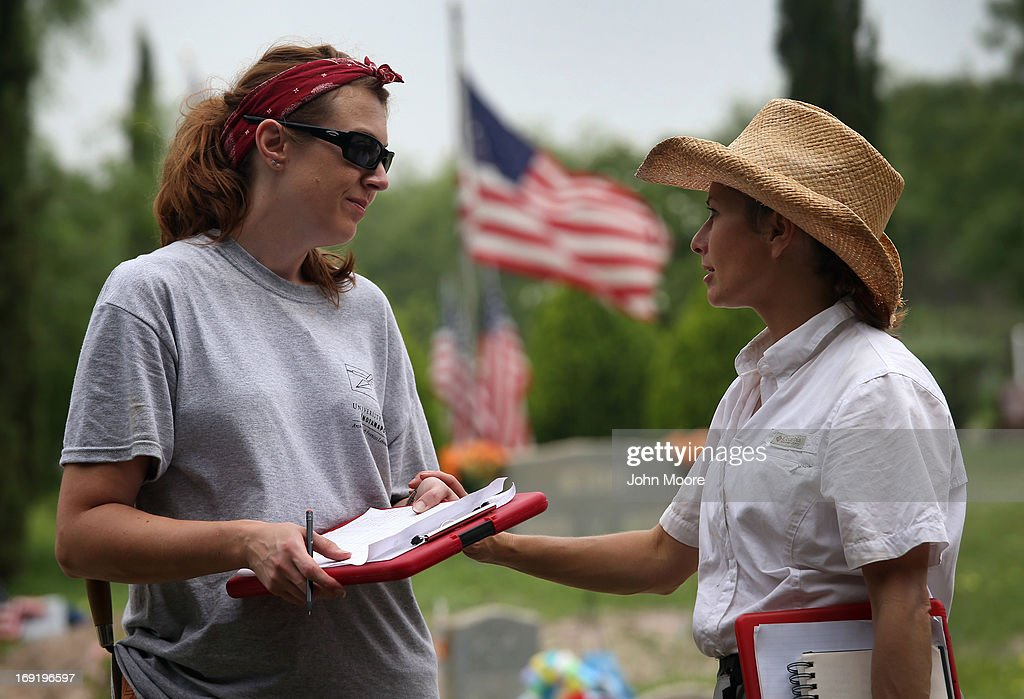 Forensic anthropologists Krista Latham (L) from the University of Indianapolis and Lori Baker from Baylor University speak as their teams exhume the remains of unidentified immigrants from a cemetery on May 21, 2013 in Falfurrias, Texas. Teams from Baylor University and the University of Indianapolis are exhuming the bodies of more than 50 immigrants who died, mostly from heat exhaustion, while crossing illegally from Mexico into the United States. The bodies will be examined and cross checked with DNA sent from Mexico and Central American countries, with the goal of reuniting the remains with families. In Brooks County alone, at least 129 immigrants perished in 2012, the highest rate in the United States, according to forensic anthropologists.