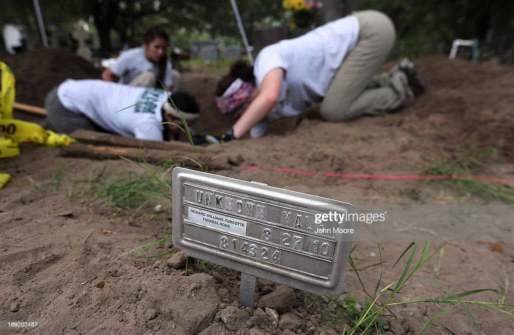 A forensic anthropology team from Baylor University enearths the remains of immigrants from a cemetery on May 21, 2013 in Falfurrias, Texas. Teams from Baylor University and the University of Indianapolis are exhuming the bodies of more than 50 immigrants who died, mostly from heat exhaustion, while crossing illegally from Mexico into the United States. The bodies will be examined and cross checked with DNA sent from Mexico and Central American countries, with the goal of reuniting the remains with families. In Brooks County alone, at least 129 immigrants perished in 2012, the highest rate in the United States, according to forensic anthropologists.