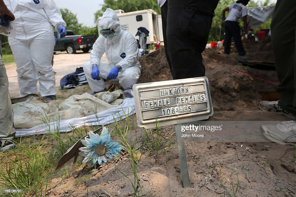 A forensic anthropology team from Baylor University exhumes the remains of unidentified immigrants at a cemetery on May 21, 2013 in Falfurrias, Texas. Teams from Baylor University and the University of Indianapolis are exhuming the bodies of more than 50 immigrants who died, mostly from heat exhaustion, while crossing illegally from Mexico into the United States. The bodies will be examined and cross checked with DNA sent from Mexico and Central American countries, with the goal of reuniting the remains with families. In Brooks County alone, at least 129 immigrants perished in 2012, the highest rate in the United States, according to forensic anthropologists.