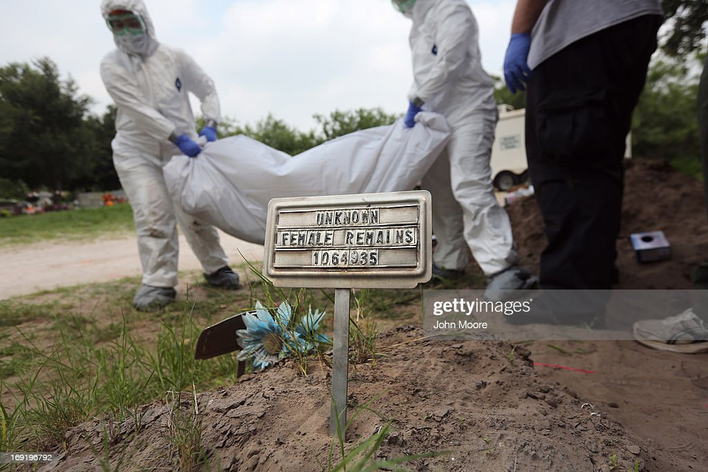 A forensic anthropology team from Baylor University unearths the remains of unidentified immigrants from a cemetery on May 21, 2013 in Falfurrias, Texas. Teams from Baylor University and the University of Indianapolis are exhuming the bodies of more than 50 immigrants who died, mostly from heat exhaustion, while crossing illegally from Mexico into the United States. The bodies will be examined and cross checked with DNA sent from Mexico and Central American countries, with the goal of reuniting the remains with families. In Brooks County alone, at least 129 immigrants perished in 2012, the highest rate in the United States, according to forensic anthropologists.
