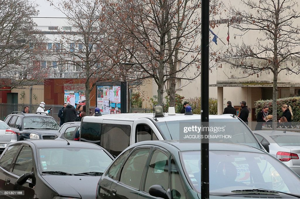 A forensic expert and a police car are seen outside JeanPerrin nursery school on December 14 in Aubervilliers a suburb northeast of Paris where a...