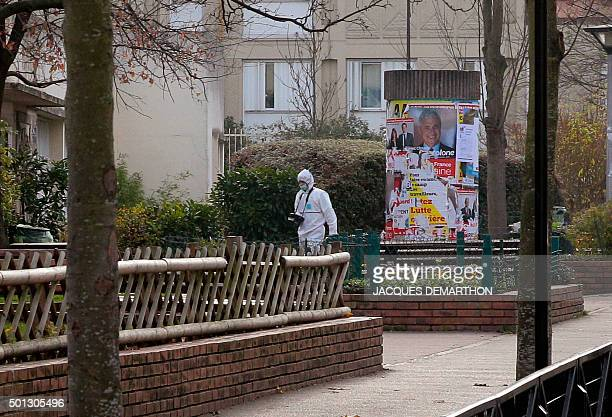 A forensic expert is seen outside JeanPerrin nursery school in Aubervilliers a suburb northeast of Paris where a teacher was attacked in the morning...