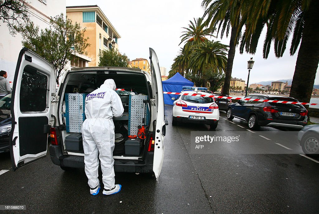 A forensic expert works on the scene where Dominique Lorenzi, a pub manager, was shot in Ajaccio, on the French mediterranean island of Corsica on February 12, 2013.