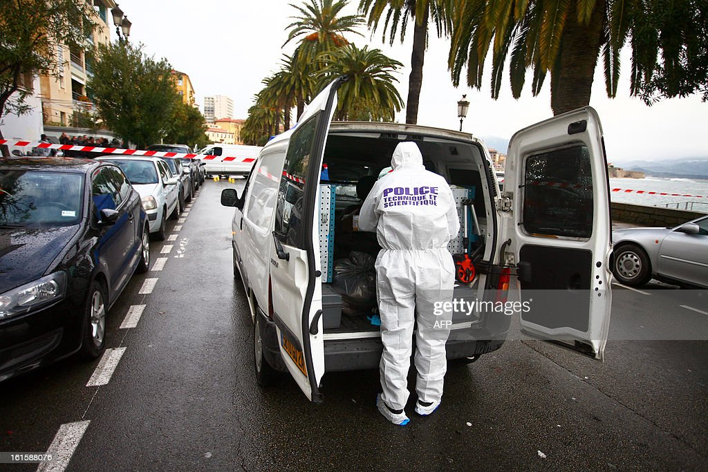 A forensic expert works on the scene where Dominique Lorenzi, a pub manager, was shot in Ajaccio, on the French mediterranean island of Corsica on February 12, 2013. AFP PHOTO/PHILIPPE MARINI