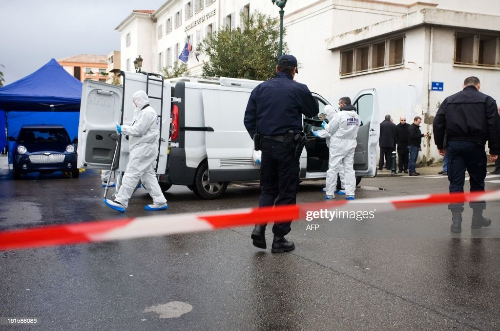 Forensic experts and police officers work on the scene where Dominique Lorenzi, a pub manager, was shot in Ajaccio, on the French mediterranean island of Corsica on February 12, 2013.