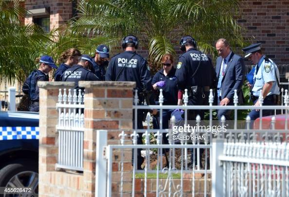 Forensic experts collect evidence from a house in the Guildford area of Sydney on September 18 2014 Australia's largest ever counterterrorism raids...