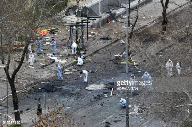 TOPSHOT Forensic experts investigate the scene of an explosion on March 14 2016 the day after a suicide car bomb ripped through a busy square in...