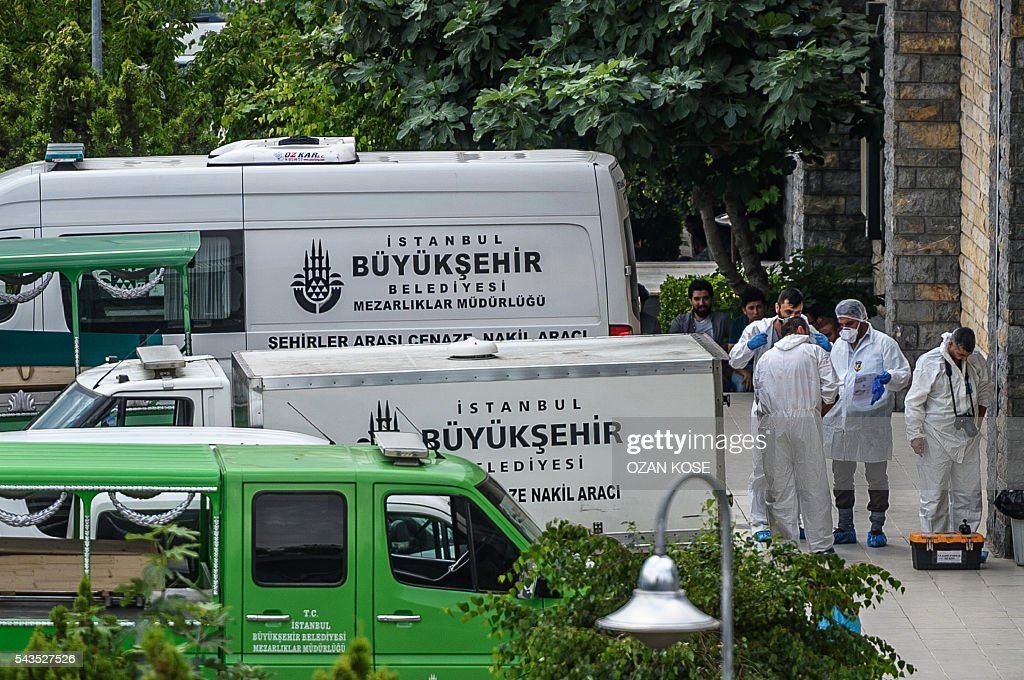 Forensic experts wait outside a building close to Istanbul's airport on June 29, 2016, a day after a triple suicide bombing and gun attack at the international airport. The bombing left 41 people dead and 239 wounded, the city governor said in a statement. The attackers began spraying bullets at the international terminal entrance before blowing themselves up at around 10:00 pm (1900 GMT) on June 28, Turkish authorities said. / AFP / OZAN