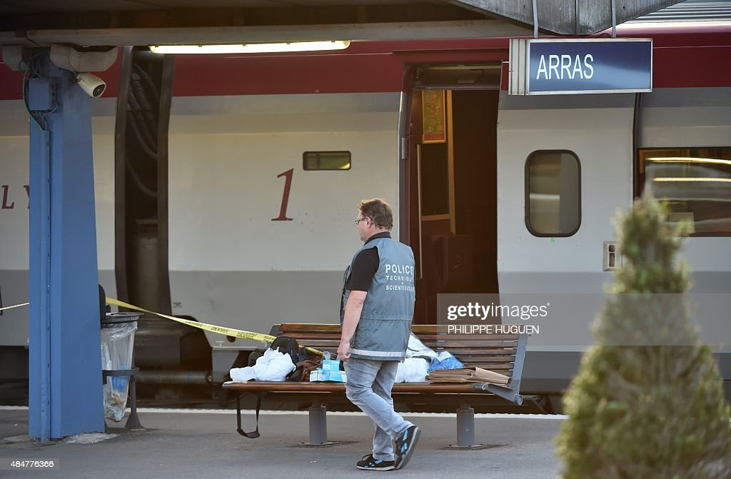 A forensic investigator is seen on a platform next to a Thalys train of French national railway operator SNCF at the main train station in Arras...