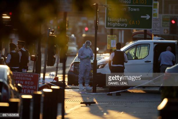 Forensic investigators work the scene in the Finsbury Park area of north London after a vehichle hit pedestrians on June 19 2017 One man was killed...
