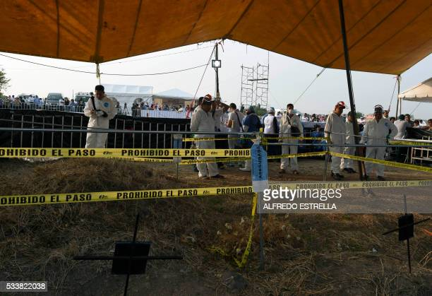 Forensic medical personnel prepare to exhume 116 bodies found in a mass grave at Tetelcingo community in Morelos State Mexico on May 23 2016 / AFP /...