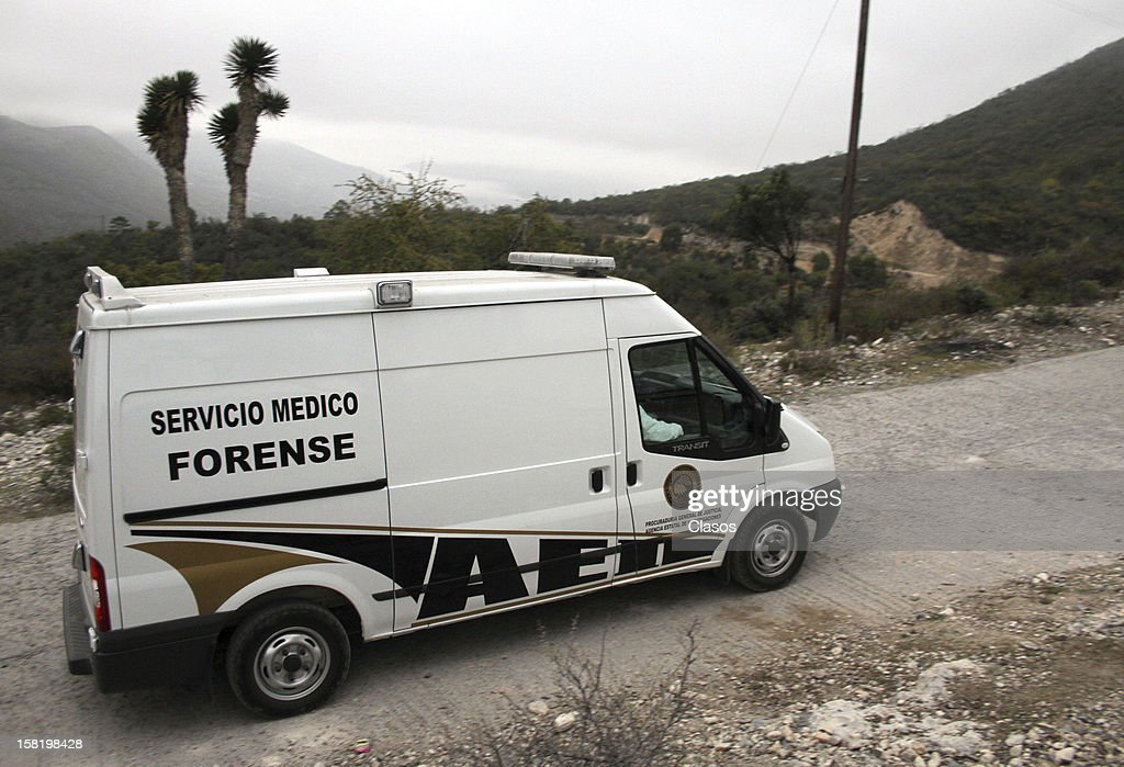 Forensic Medical Service staff move the remains of singer Jenni Rivera who died on December 09, 2012 in a plane crash near the ranch on Tejocote, in the town of Iturbide, Nuevo Leon on December 10, 2012 in Nuevo Leon, Mexico.