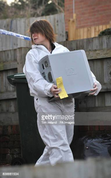 A forensic officer carries a computer from Mold Crescent in Banbury Oxfordshire where Sally Cox and 22yearold Martin Faulkner were murdered