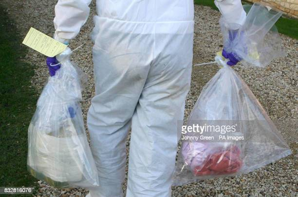 A forensic officer carries away two bags from a crime scene at Templeton College in Kennington Oxfordshire after two incendiary devices were found at...