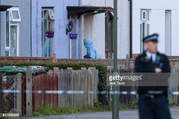 A forensic officer enters a property on Cavendish Road during a raid in connection with the terror attack at Parsons Green station on September 16...
