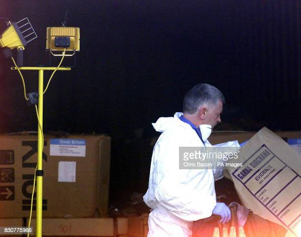 A forensic officer examines the inside of the lorry in which eight wouldbe refugees died and five others were left seriously ill A plot to smuggle...