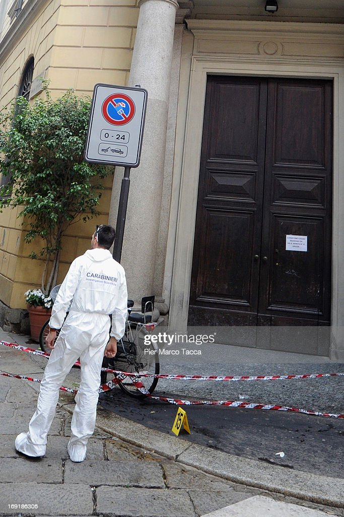 A forensic officer is seen on the Via della Spiga street after the robbery at watchmaker Franck Muller store on May 21, 2013 in Milan, Italy. The thieves launched molotov cocktails in an attempt to stop pursuers with two people injured during the raid. The value of the loot has not been revealed.