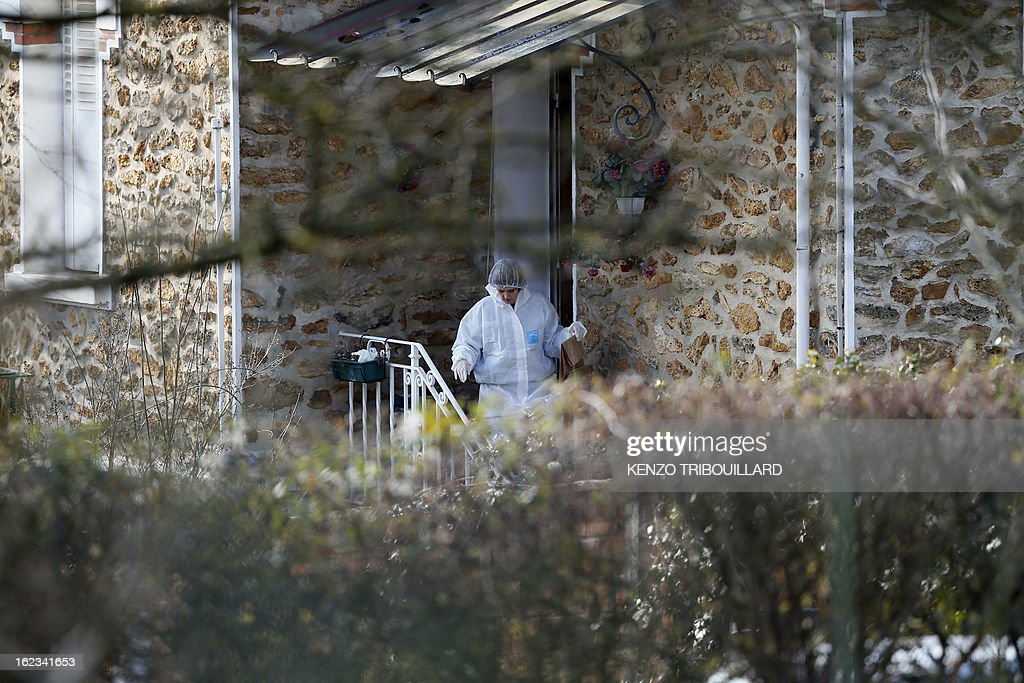 A forensic officer leaves with a bag after looking for evidence in the house where three children, aged 9, 11 and 17, two boys and their sister, were found dead by their father, on February 22, 2013, in Dampart, east of Paris. They were presumably throat-cutting according to police sources. The mother is missing and unreachable.