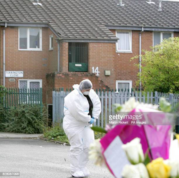 A forensic officer walks past in Terrington Close Chorlton where a sixyearold boy was found by his father murdered in his bedroom police said...