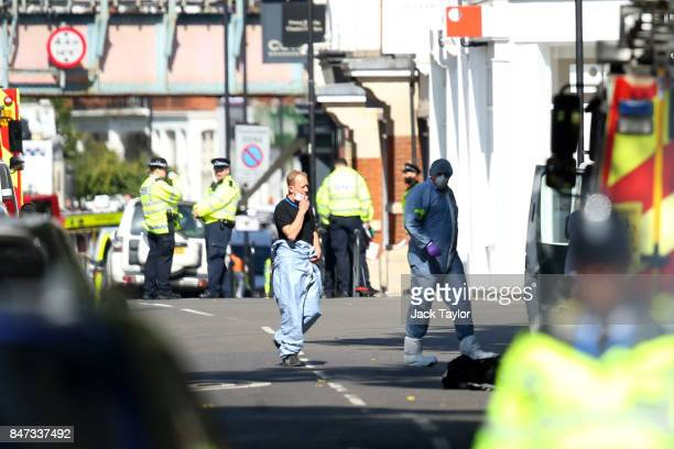 Forensic officers are seen at Parsons Green Underground Station on September 15 2017 in London England Several people have been injured after an...