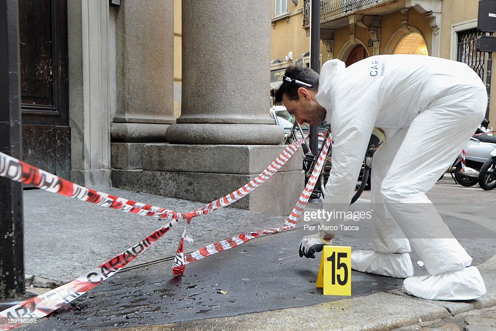 Forensic officers are seen taking samples on the Via della Spiga street after the robbery at watchmaker Franck Muller store on May 21, 2013 in Milan, Italy. The thieves launched molotov cocktails in an attempt to stop pursuers with two people injured during the raid. The value of the loot has not been revealed.