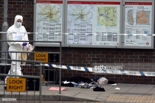 Forensic officers at the scene in Hammersmith Broadway Bus Station in London where a 14yearold boy has been stabbed The teenager who is in a serious...