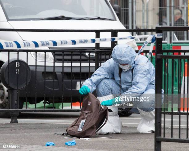 Forensic Officers collect evidence at the scene after a man was arrested following an incident in Whitehall on April 27 2017 in London England