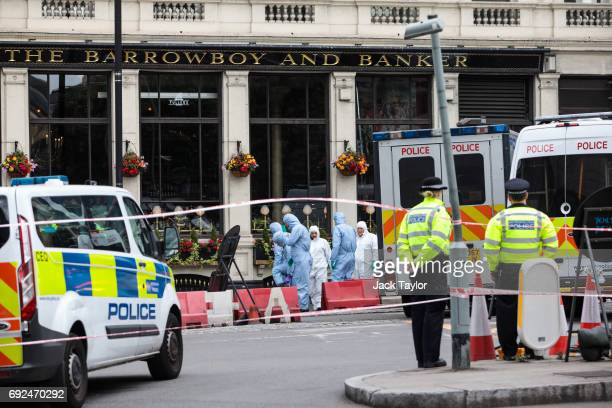 Forensic officers continue their work along Borough High Street following the June 3rd terror attack on June 5 2017 in London England Seven people...
