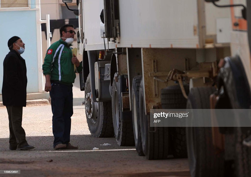 Forensic officers inspect refrigerated trucks in In Amenas transporting the bodies of victims that were killed during the hostage crisis at a desert gas plant in the desert in Algeria's deep south, to hospital for identification on January 21, 2012. Two days after Algerian forces ended a hostage crisis at a desert gas plant, the exact toll of those killed in the bloodbath remained unknown, amid fears the total number of hostages who died could reach 50.