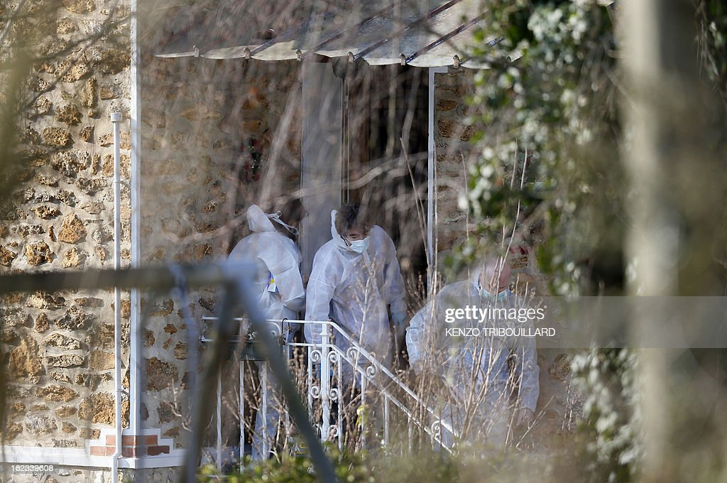 Forensic officers leave after looking for evidence in the house where three children, aged 9, 11 and 17, two boys and their sister, were found dead by their father, on February 22, 2013, in Dampart, east of Paris. They were presumably throat-cutting according to police sources. The mother is missing and unreachable.