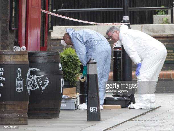 Forensic officers search for evidence outside The Anchor a Thameside pub nearby London Bridge on June 4 2017 following last night terror attack at...