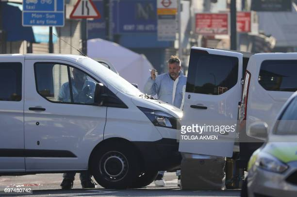 Forensic offiers work at the scene in Finsbury Park area of north London after a vehichle hit pedestrians on June 19 2017 One man was killed and...