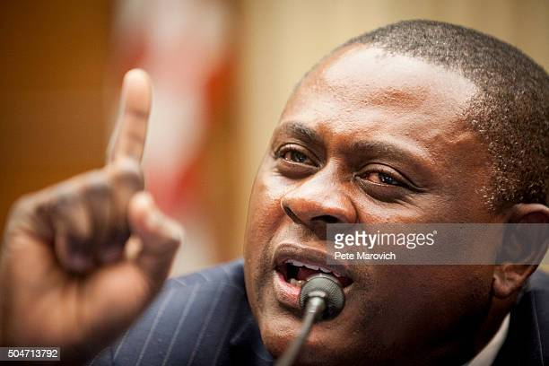 Forensic pathologist and neuropathologist Dr Bennet Omalu who discovered CTE in former NFL players participates in a briefing sponsored by Rep Jackie...