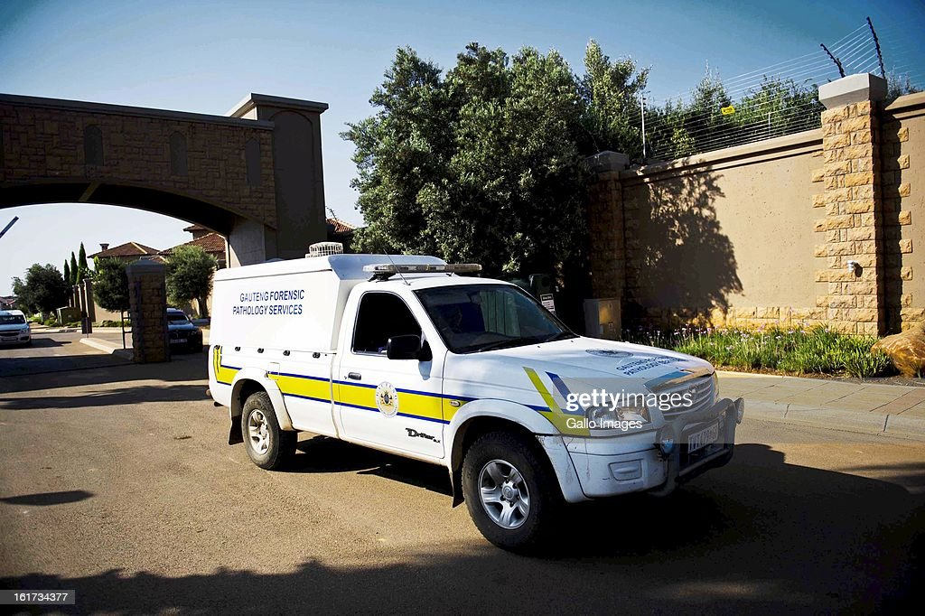 A forensic pathology van leaves Oscar Pistorius's residential area on February 14, 2013 in Pretoria, South Africa.Pistorius was arrested following a shooting at his residence; he was taken to Boschkop Police Station