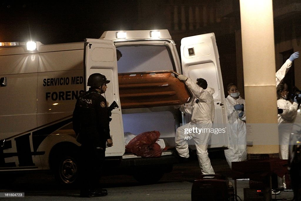 Forensic personnel and police arrive at the scene of a crime where four people were shot dead in Monterrey City, Nuevo Leon state on February 11, 2013. At least 70,000 people have died in drug-related violence since 2006, when troops were deployed to battle drug cartels, according to the new government, which took over in December. AFP PHOTO / Julio Cesar AGUILAR