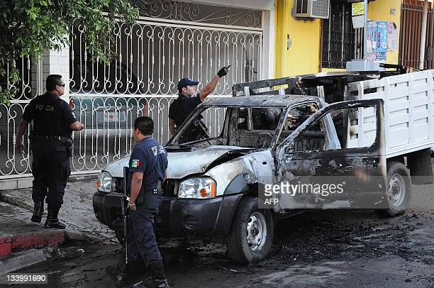 Forensic personnel work next to a truck with burned bodies on November 23 2011 in Culiacan Sinaloa Mexico 16 burned bodies were found in two trucks...