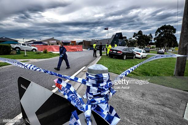 Forensic police are seen at the scene where a man was shot dead after stabbing two counter terrorism officers in the suburb of Endeavour Hills on...