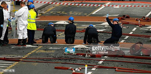 Forensic Police go over the scene at Glasgow Airport after an incident with a car being driven at the airports main terminal July 1 2007 in Glasgow...