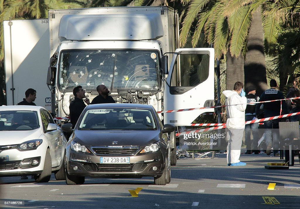 Forensic police investigate a truck at the scene of a terror attack on the Promenade des Anglais on July 15, 2016 in Nice, France. A French-Tunisian attacker killed 84 people as he drove a truck through crowds, gathered to watch a firework display during Bastille Day celebrations. The attacker then opened fire on people in the crowd before being shot dead by police.