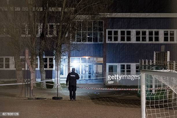 A forensic police investigates in front of Wilds Minne school in Kristiansand Norway on December 5 where a woman and a boy died after being stabbed /...