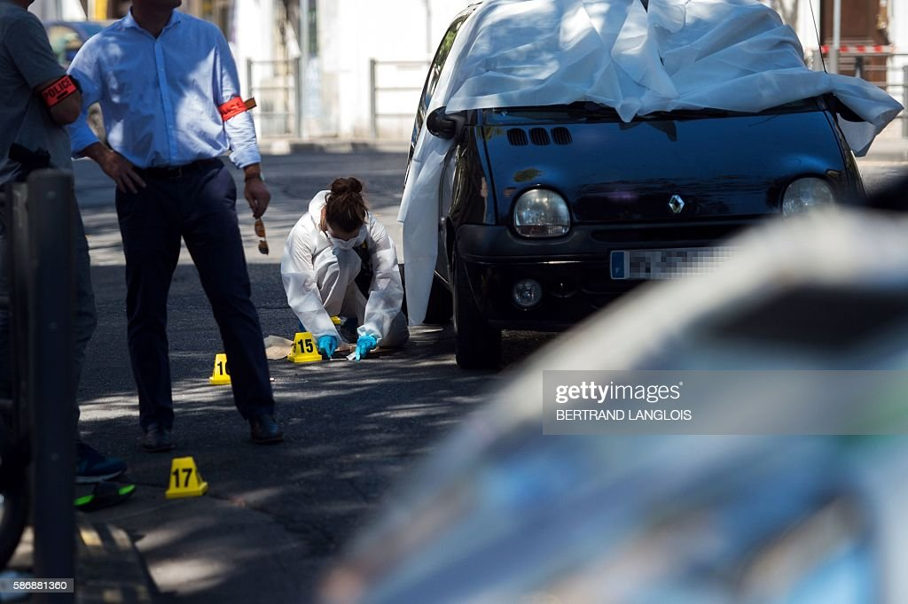 A Forensic police officer investigates by the car where two men in their twenties were shot dead near the train station SaintCharles in Marseille...