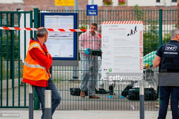 A forensic police officer works in a cordonedoff safety perimeter set by Gendarmes at the railway sation in Noyon northeast of Paris following a...