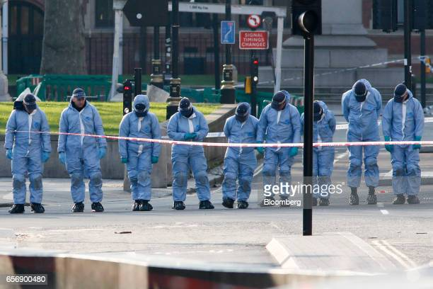 Forensic police officers search for evidence near the Houses of Parliament following a terror attack in central London UK on Wednesday March 22 2017...