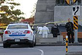 Forensic police officers work near the National War Memorial in Ottawa Canada on Wednesday October 22 2014 A gunman opened fire at the National War...
