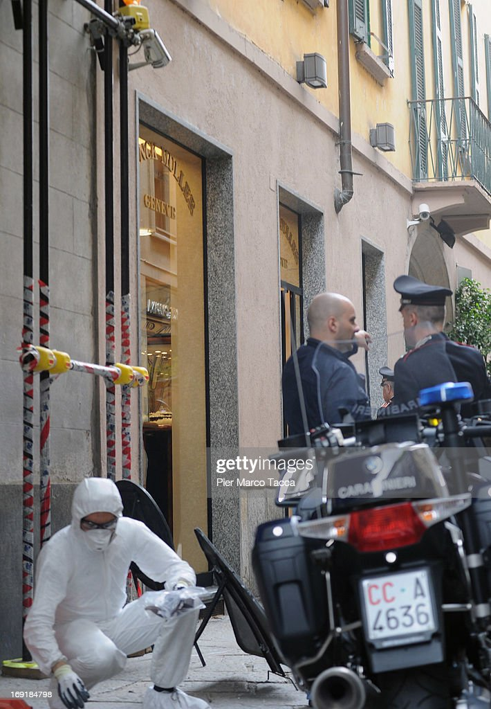 Forensic police pick up garments left by the robbers outside the watchmaker Franck Muller store on the Via della Spiga street on May 21, 2013 in Milan, Italy. The thieves launched molotov cocktails in an attempt to stop pursuers with two people injured during the raid. The value of the loot has not been revealed.