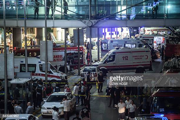 Forensic police work the explosion site at Ataturk airport on June 28 2016 in Istanbul after two explosions followed by gunfire hit Turkey's biggest...