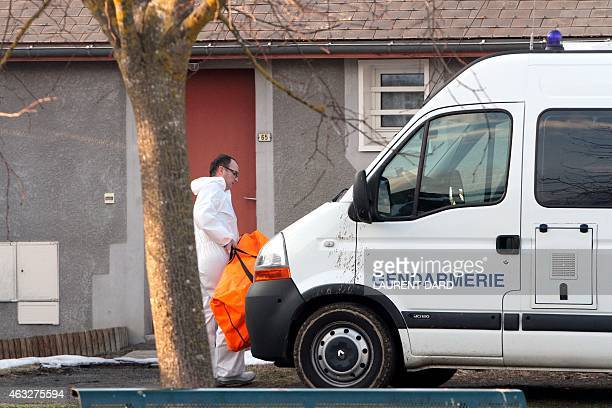 Forensic policeman is seen in the garden of a house where a father killed two of his children before committing suicide on February 12 2015 in...