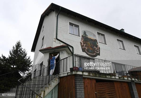 A forensic policeman is seen on December 2 2016 in front of a house where six bodies have been found yesterday in Boeheimkirchen Lower Austria The...
