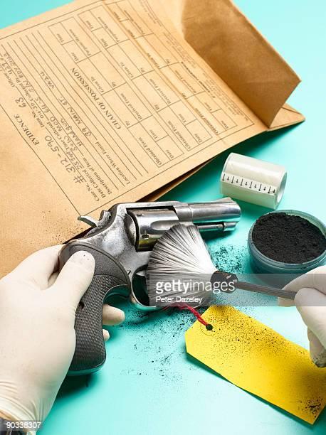 Forensic scientist dusting for finger prints.