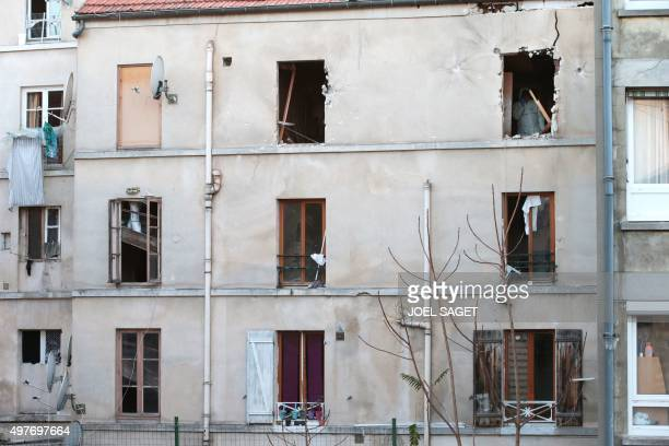 A forensic scientist of the French police searches for evidence in the apartment raided by French Police special forces earlier in the northern Paris...